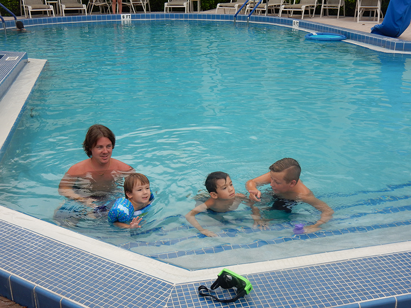 Family in the pool.